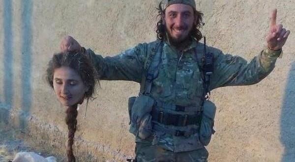 Армия ИГИЛ смешанная: есть добровольцы и призывники, наёмники, особенно ценятся чеченцы. Везде по-разному. Так, в Ираке много именно волонтёров, мотивированных ненавистью к шиитам и курдам / На фото: боевик ИГИЛ показывает голову курдской девушки
